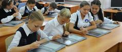 С 2015 года школьные учебники будут иметь электронную копию