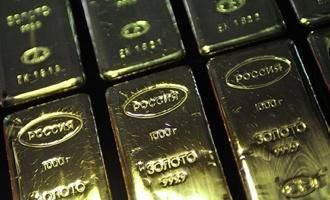 Доллар дешевеет, золото растет