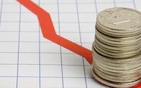 Рубль вновь снизился из-за падения цен на нефть