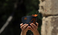 Олимпийский огонь для Игр в Сочи пронесут 14 тысяч факелоносцев
