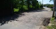 Дорога к парку «Дружба» местами ещё не заасфальтирована