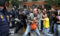 Десятки демонстрантов пострадали в столкновениях с полицией в Мадриде