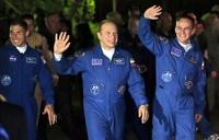 Космонавты, вынесшие в космос олимпийский факел, вернулись на землю