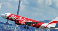 «Худший кошмар»: один самолет малайзийской AirAsia пропал, второй — едва не разбился